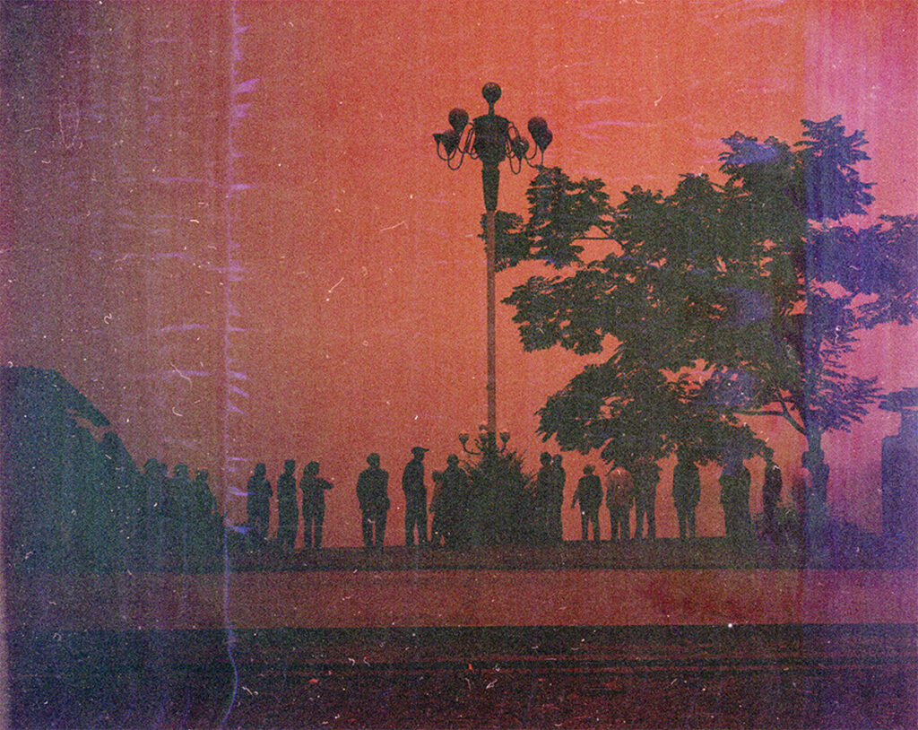 Image showing the silhouettes of a line of people, a tree and a lamppost. The scene is overlaid with a red hue.