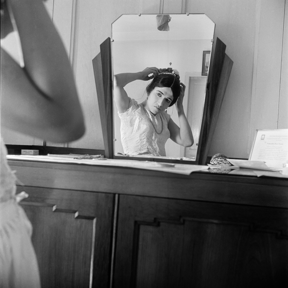 Theatre Artiste, Bombay, Early 1940s, Homai Vyarawalla. A woman is seen sat at a dressing table in the mirror fixing her hair