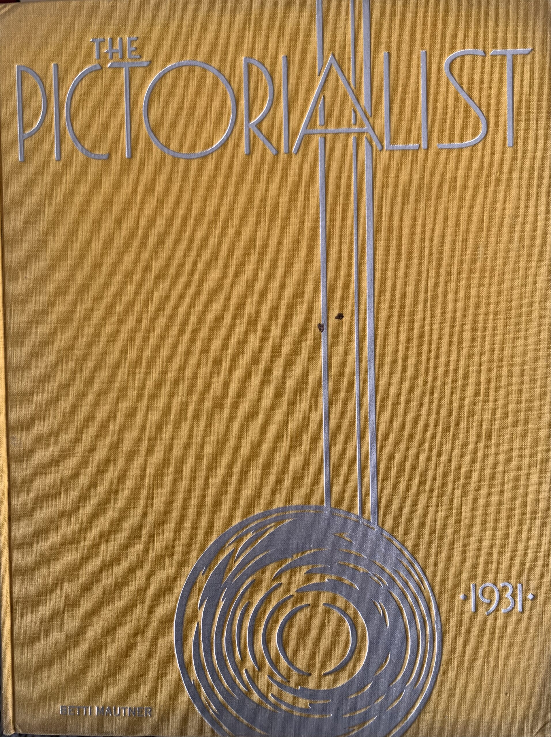 The Pictorialist photobook by Betti Mautner. Published 1931. Image courtesy of James Hyman. The yellow cover of the book is seen.