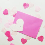 Seed Heart with envelope and pink heart-shaped confetti