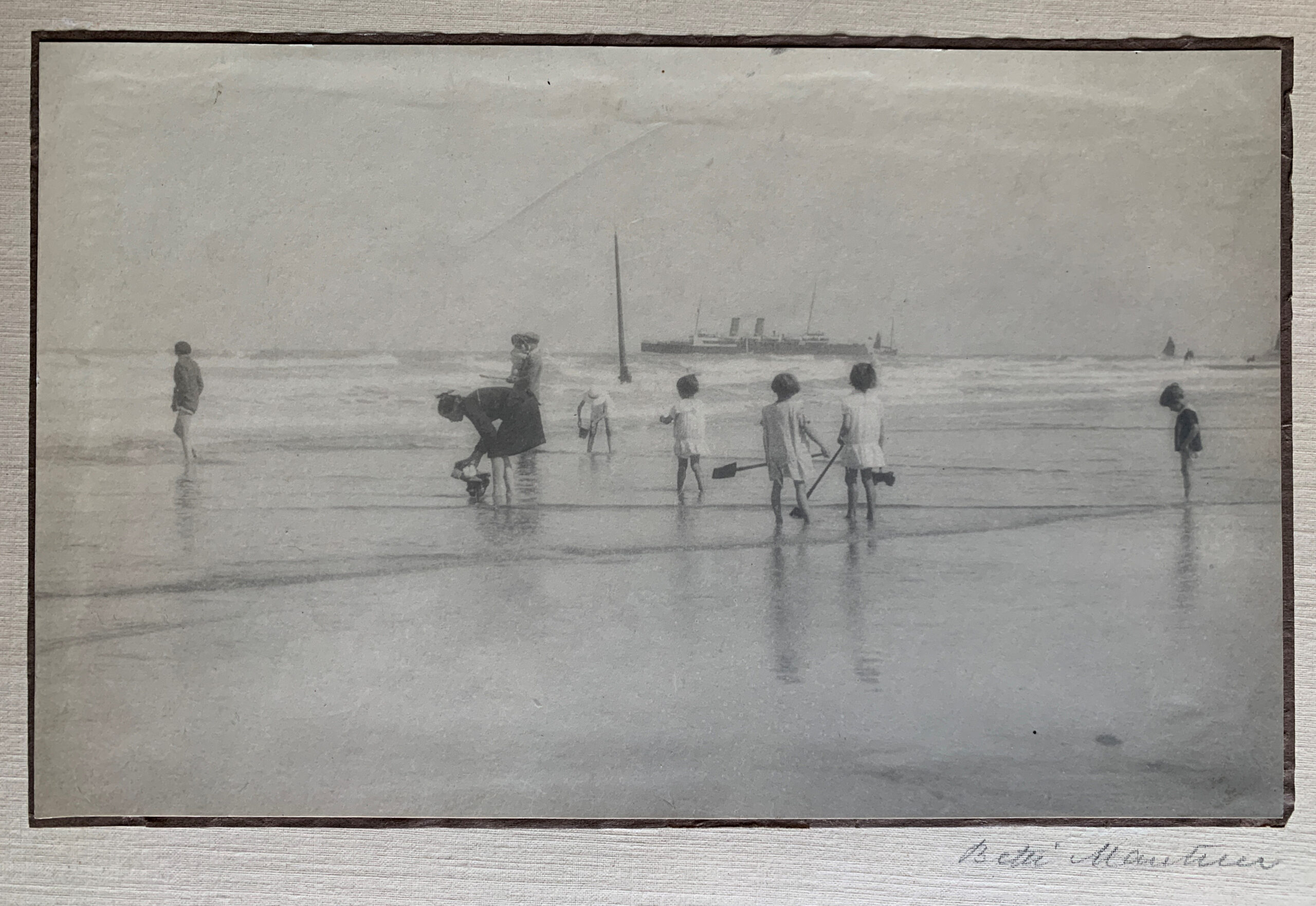 A Misty Morning Beach Gossip, 1919 by Betti Mautner © James Hyman. Children with spades are digging at the waters edge of the beach.
