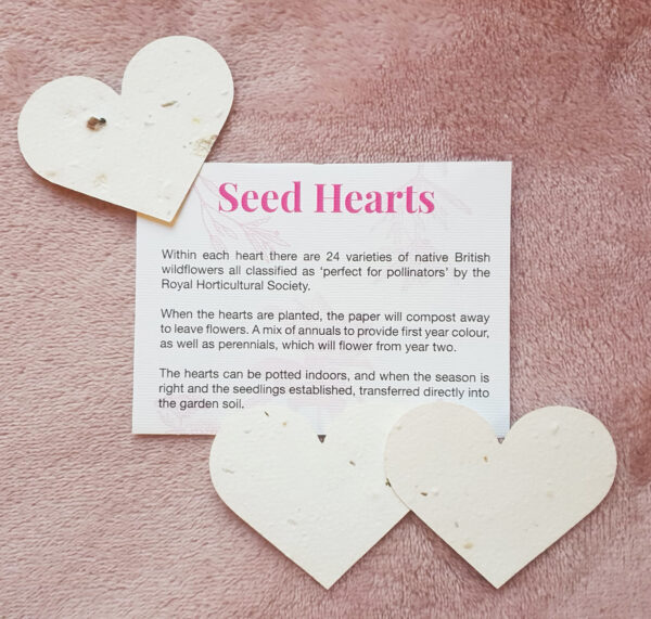 Three seed hearts with sowing instructions on plush pink fabric