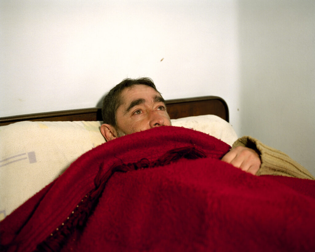 Man in bed, Pension la Parra, Ferrol, Galicia, Spain. 2018 © Lua Ribeira / Magnum Photos