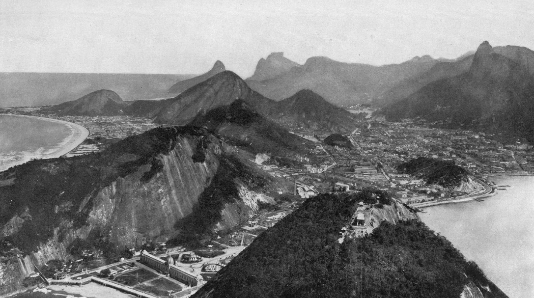 Black and white image of Botafogo bay and Copacabana when it was just a resort area, from the summit of Pão de Açucar, 1919. by Harriet Chalmers Adams